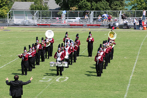 FSCC's band in formation on the field performing their music.