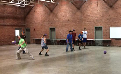 Students from the Collegiate Farm Bureau Club lined up and throw balls at each other in a game of dodge ball.