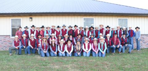 The entire rodeo team posing for a group photo.