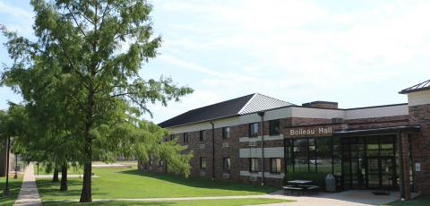 A picture of Boileau Hall's front entrance on a clear sunny day.